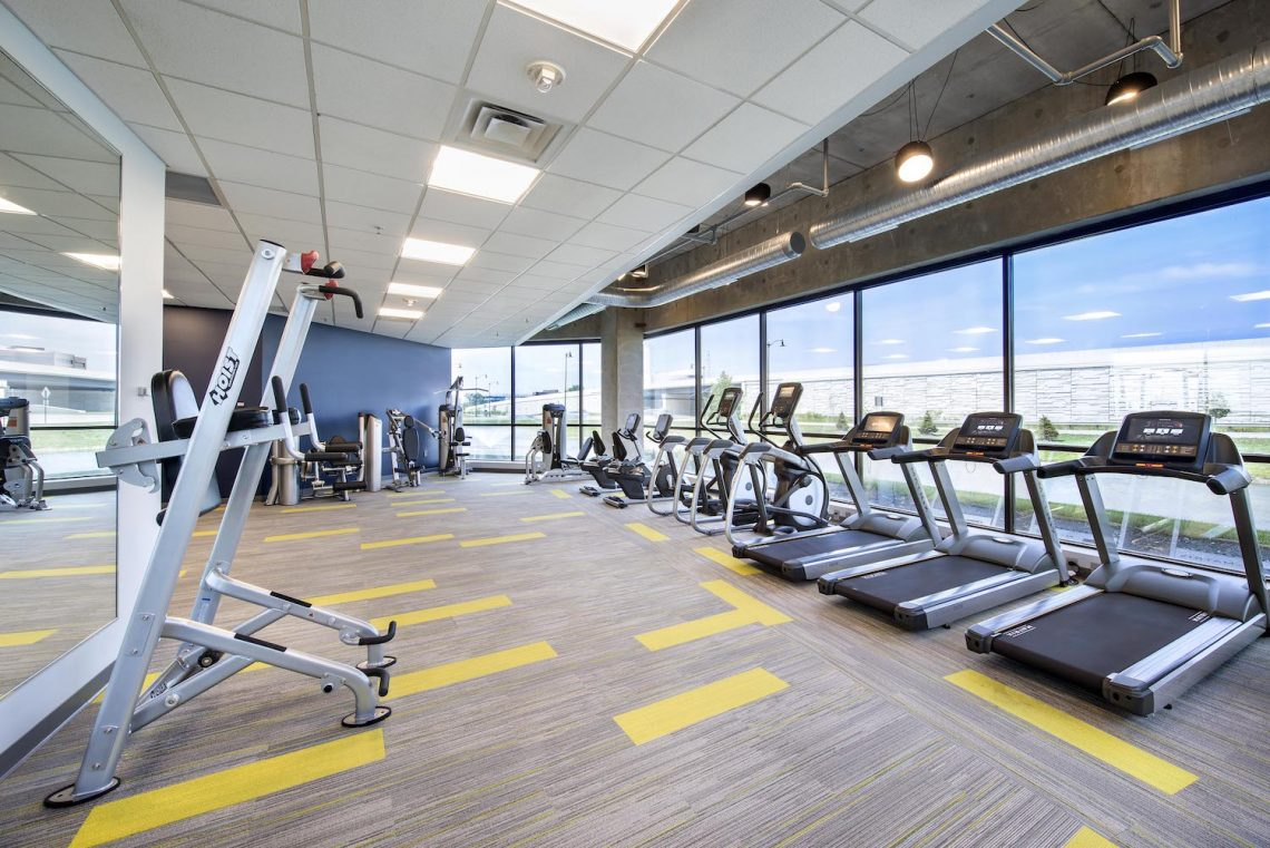 Modern fitness center with various exercise equipment options located in the Meridian Mark buildings