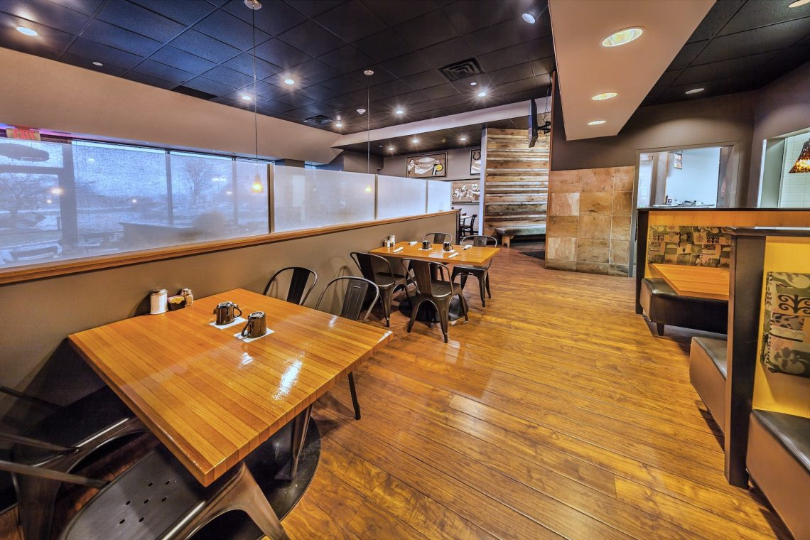 Cozy tables and booth seating in the full service Sunrise Cafe located in the Meridian Mark II building