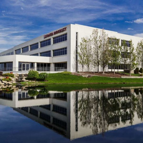 2245 Sequioa Drive in Aurora, IL, and managed by Zeller with reflecting pond and side of building.