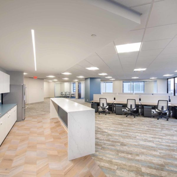 Empty office suite with desks and chairs inside the Zeller managed Capital Center building.
