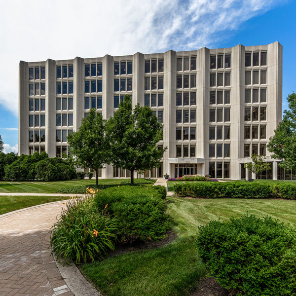 Grass, trees and front door of Zeller's Commerce Plaza office building in Oak Brook.