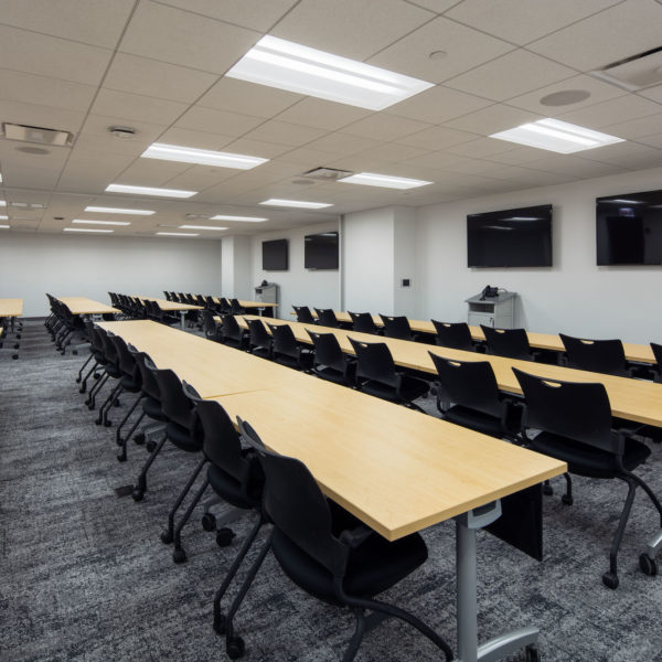 Empty conference room with long tables at Commerce Plaza in Oak Brook, IL, a Zeller office building.
