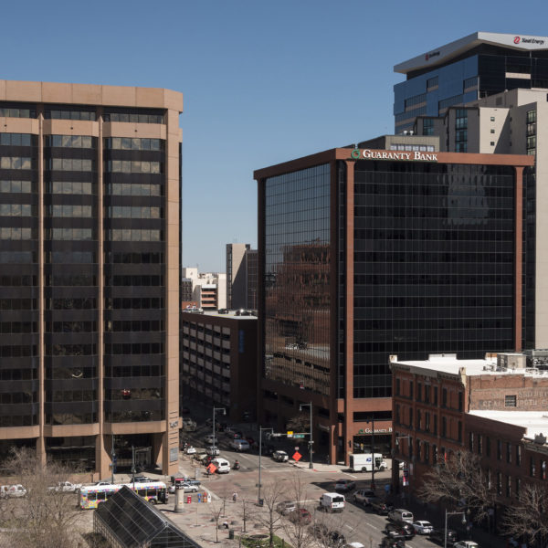 The tops of the two LoDo Towers managed by Zeller in downtown Denver, CO