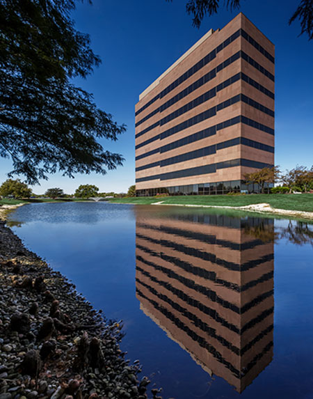The entire Meridian Mark II office building in Carmel, IN, managed by Zeller and the reflecting pool.