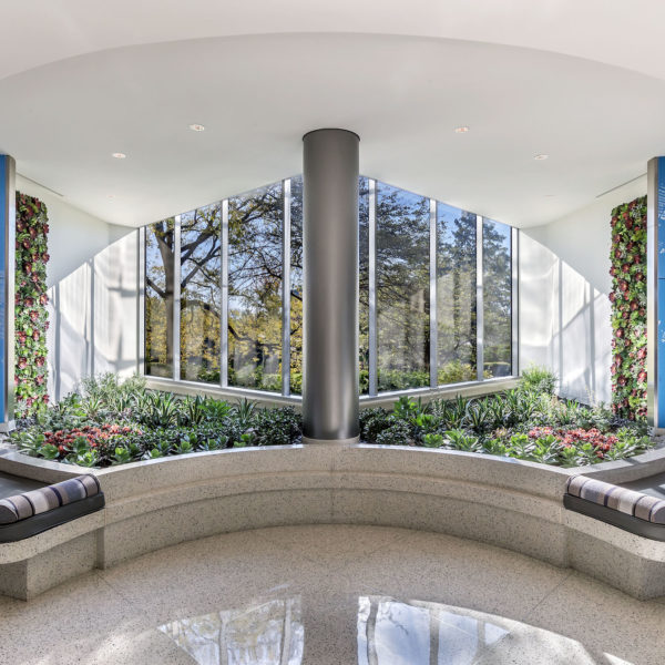 The lounge with windows and flowers in the Zeller managed Old Orchard Towers office building.