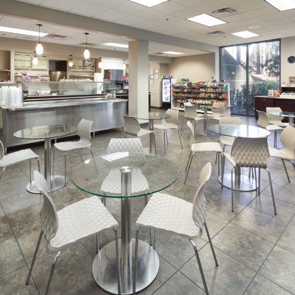 Chairs and glass tables in the cafe located at Premier Plaza in Atlanta.