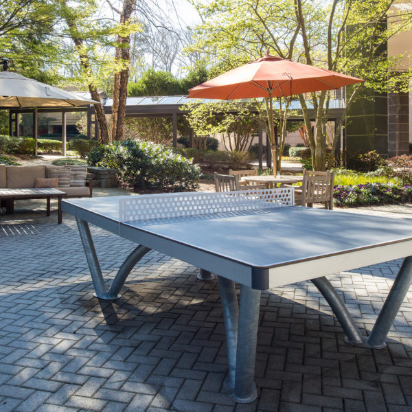 The Premier Plaza outdoor courtyard complete with ping pong tables in Atlanta.