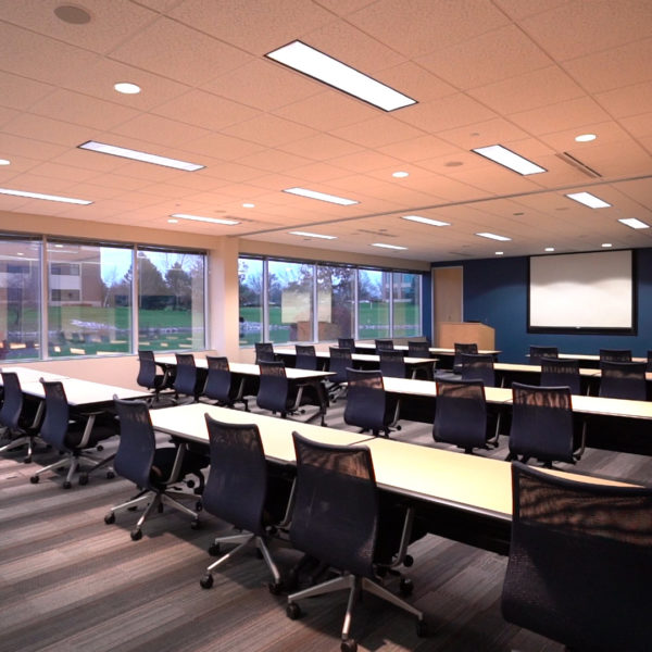 Conference room with tables and chairs at Riverwood Corporate Center in Pewaukee, WI.