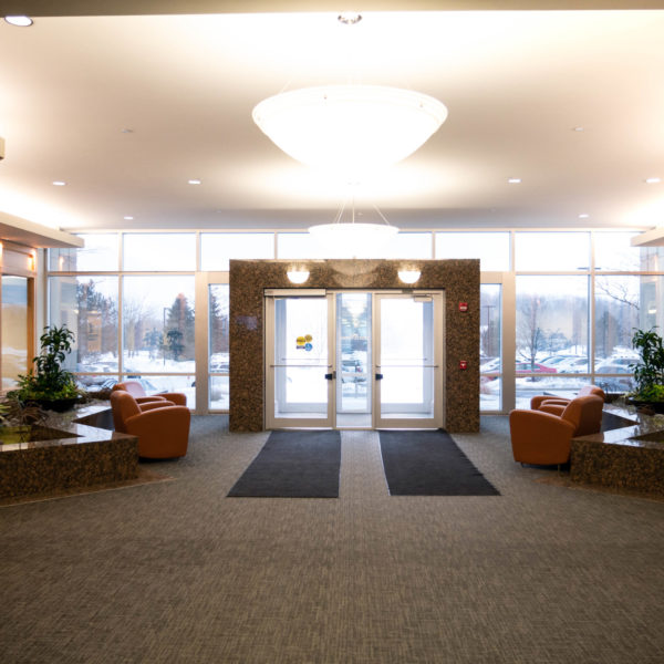 The lobby and front doors of the Riverwood Corporate Center managed by Zeller and located in Pewaukee, WI.
