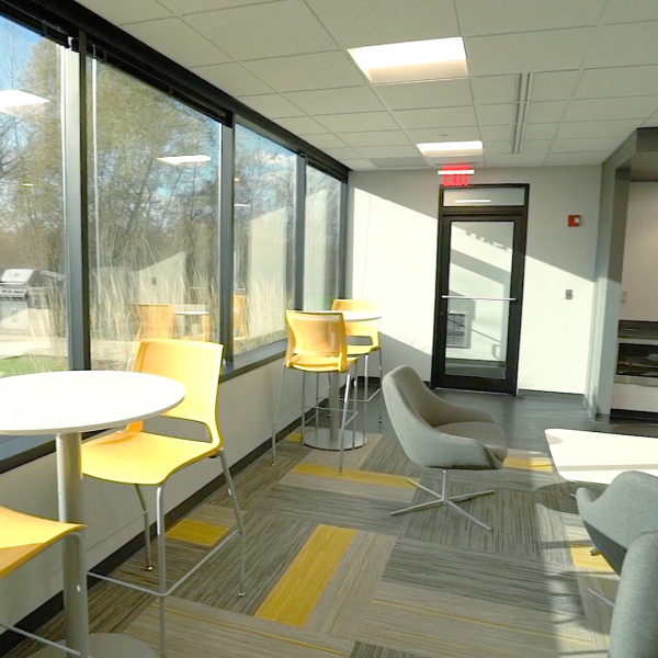 Chairs and tables in a lounge area in the Riverwood Corporate Center in Pewaukee, WI, lounge area.