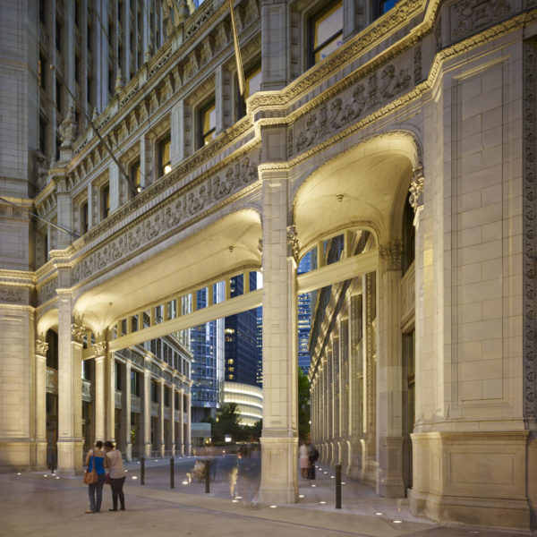 Beautiful outdoor tenant passage with columns and arches at The Wrigley Building in Chicago, IL, managed by Zeller, scaled.