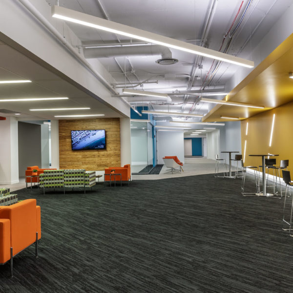 Tenant lounge with chairs and tables at the Zeller managed Woodfield Preserve Office Center in Schaumburg, IL.
