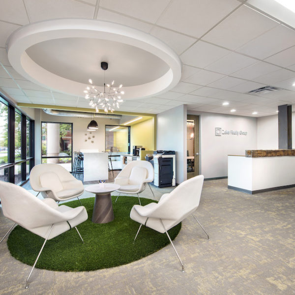 Tables, chairs and reception area of office suite located in Castle Creek building.